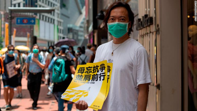 Defiance and fear as Hong Kong settles into new normal after China-backed law takes hold