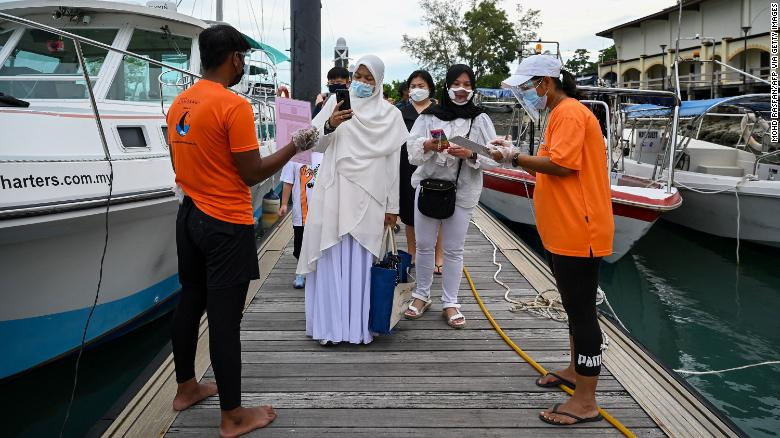 Malaysia Thailand and Vietnam are leaving their zero-Covid policies behind but they aren't ready to open up experts warn